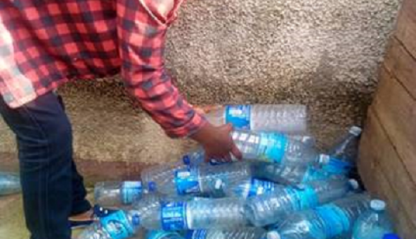 Kabuo Rose with the plastic bottles that she collected in Katwe